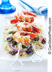 Barbecued prawns on a couscous salad, with toasted pistacchios, almonds, pine nuts and raisins.