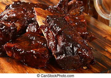 Baby pork or beef ribs with barbecue sauce
