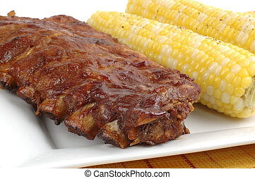 Barbecued Ribs - Rack of delicious ribs with corn on the...