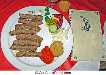 barbecued sausages served in a restaurant on the border between Italy and Slovenia