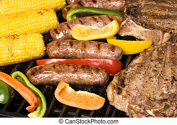 Barbecued steak, bratwurst and corn on the cob - A barbecue...