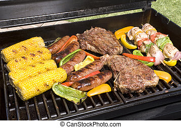 Barbecued steaks, brats, corn and chicken