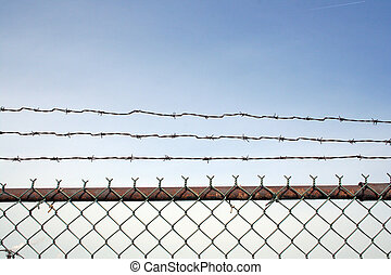 A rusty barbed wire fence