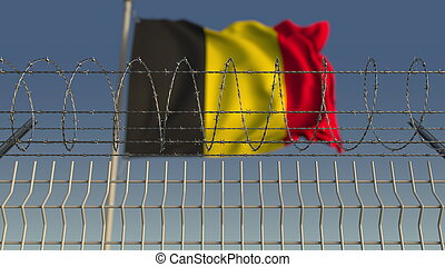 Barbed wire against waving flag of Belgium. 3D rendering