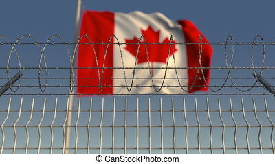 Barbed wire against waving flag of Canada. Loopable 3D...