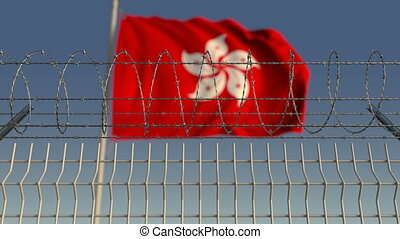 Barbed wire against waving flag of Hong Kong. Loopable 3D...