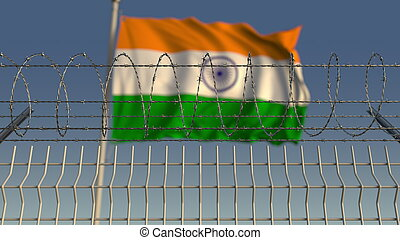 Barbed wire against waving flag of India. 3D rendering