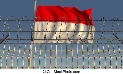 Barbed wire against waving flag of Indonesia. 3D rendering