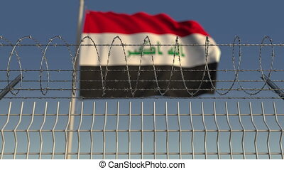 Barbed wire against waving flag of Iraq. Loopable 3D...