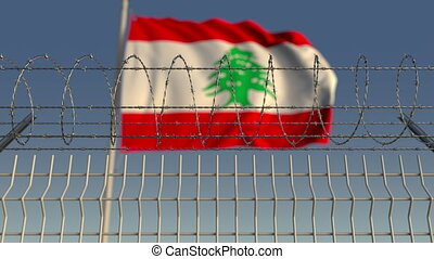 Barbed wire against waving flag of Lebanon. Loopable 3D...