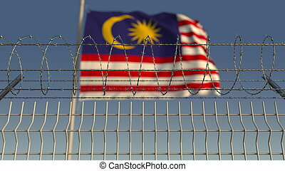 Barbed wire against waving flag of Malaysia. 3D rendering