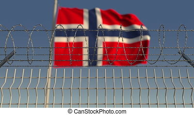 Barbed wire against waving flag of Norway. Loopable 3D...