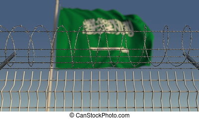 Barbed wire against waving flag of Saudi Arabia. Loopable 3D...