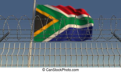 Barbed wire against waving flag of South Africa. Loopable 3D animation