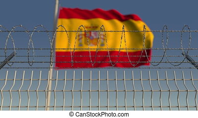 Barbed wire against waving flag of Spain. Loopable 3D...