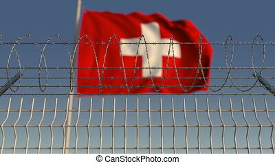 Barbed wire against waving flag of Switzerland. Loopable 3D...