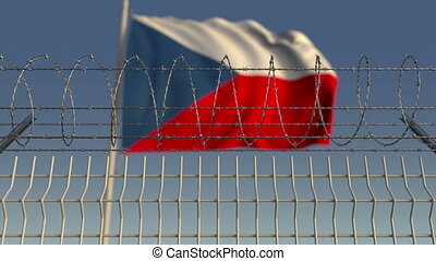 Barbed wire against waving flag of the Czech Republic....