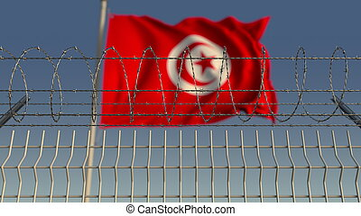 Barbed wire against waving flag of Tunisia. 3D rendering - ...