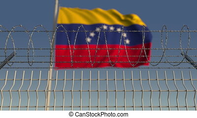 Barbed wire against waving flag of Venezuela. Loopable 3D...