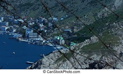 Barbed wire and city - Barbed wire on the background of a...