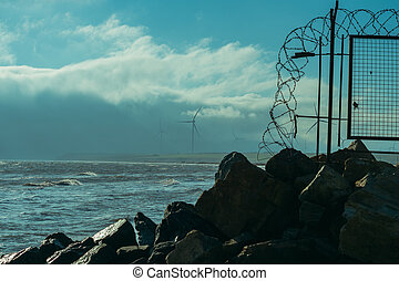 Barbed wire. Barbed wire fence near the sea.