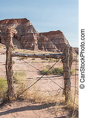 Barbed Wire Fence Along Desert Rocks in backcountry of Zion