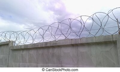 Barbed wire fence sky and clouds