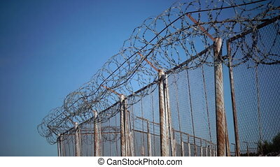 Barbed wire, fencing territory. Closed to visit place....