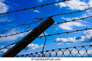 Barbed wire on blue sky