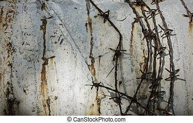 Barbed wire on grunge metal background