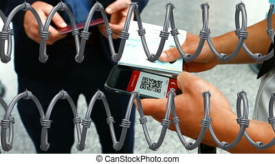 Barbed wires against hands holding passport and using ...