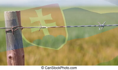 Animation of barbed wire over national flag of Slovakia waving on rural landscape. Covid 19 coronavirus pandemic travel restrictions digital composite.