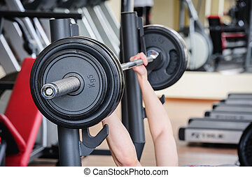 barbell bench press workout in the gym
