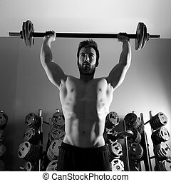 Barbell man workout fitness at weightlifting gym