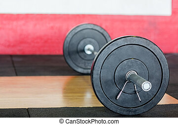 Barbell On Floor In Fitness Center - Closeup of barbell on...