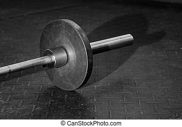 Barbell on the floor - Image of a barbell on the floor of a ...