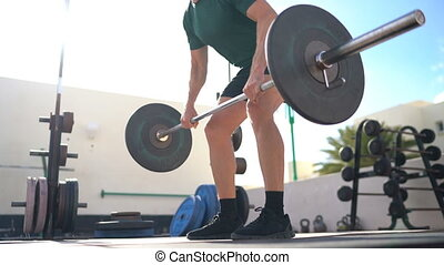 Barbell Row - Weightlifting man doing bent over row bodybuilding powerlifting