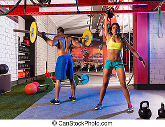 Barbell weight lifting man woman rising kettlebell