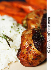 Barbeque chicken meal with rice and carrot