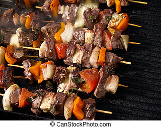 Barbeque cookery, close-up. - Barbeque cookery outdoors.