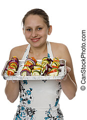 girl with vegetables prepared to the baking on the grill