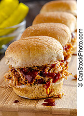 Barbeque Pulled Pork Sandwiches - Close up of row of pulled...
