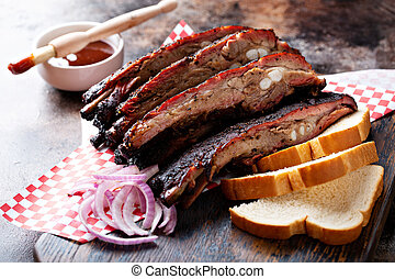 Barbeque ribs with red onion