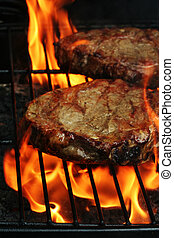 Barbeque Steaks - Two Juicy stakes grilling on the barbeque ...
