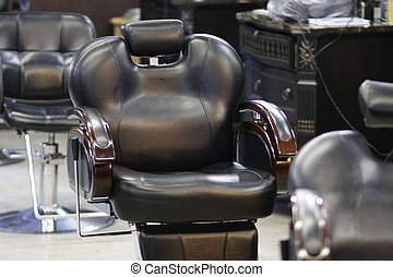 Barber chairs in a barber shop.