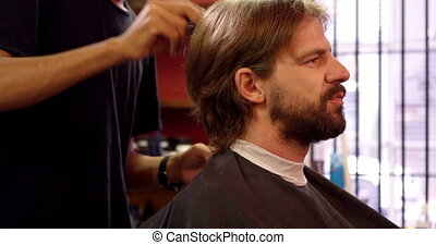 Barber combing mans hair 4k - Barber combing mans hair at...