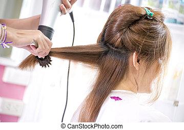 Barber dry hair in salon - Barber dry brown hair in salon