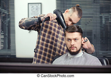 Barber makes a haircut