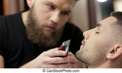 Barber shave and modeling beard at the hair salon - Men's...