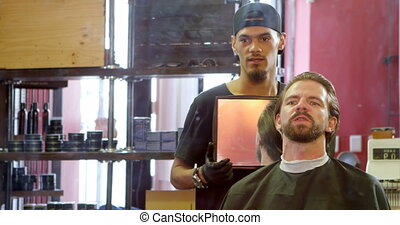 Barber showing man his haircut in mirror 4k - Barber showing...